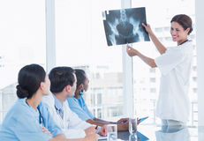 Doctor explaining xray to her team during a meeting Stock Images