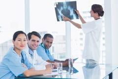 Doctor explaining xray to her team Stock Photos
