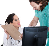 Doctor Explains Patient Record To The Male Nurse Stock Photos