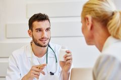 Doctor explains tablet consumption. For therapy royalty free stock photography