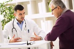 Doctor explains to patient about healthy Stock Photo
