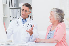 Doctor explaning reports to patient on computer Royalty Free Stock Images