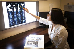 Doctor explores images of computer tomography Royalty Free Stock Photos