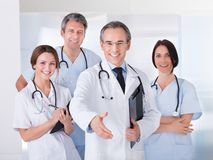Doctor Extending His Hand To Shake stock photos