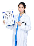 Doctor with eye chart. Isolated on white stock photos