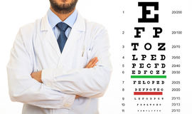 Doctor and eye vision test stock photos