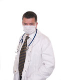 Doctor with face mask looks intently at camera Royalty Free Stock Photography