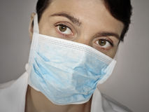 Doctor face with a surgical mask Royalty Free Stock Photo