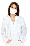 Doctor with a facemask Stock Photography