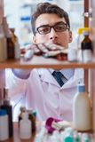 The doctor at farmacy retail shop looking for medicines. Doctor at farmacy retail shop looking for medicines Royalty Free Stock Image