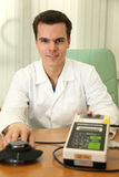 Doctor with fat measurer Stock Image