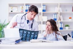 The doctor feeling pessimistic about x-ray image of patient. Doctor feeling pessimistic about x-ray image of patient Royalty Free Stock Photography