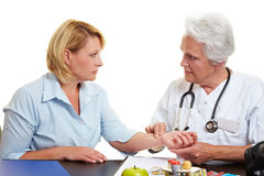 Doctor feeling pulse with fingers Royalty Free Stock Images