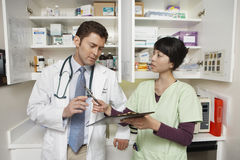 Doctor With Female Assistant Stock Photography