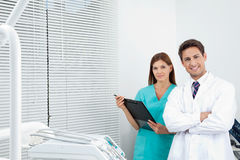 Doctor And Female Assistant In Dental Clinic Stock Photography