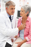 Doctor with female patient Royalty Free Stock Photo