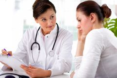 Doctor with female patient. Doctor explaining diagnosis to her female patient Royalty Free Stock Photography