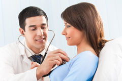 Doctor and female patient Royalty Free Stock Photo