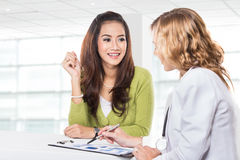 Doctor with female patient. Friendly, Happy Doctor with Stethosc Royalty Free Stock Photography