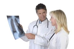 Doctor and female patient talking about x-ray of lungs Royalty Free Stock Photography
