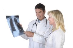 Doctor and female patient talking about x-ray of lungs Stock Images