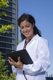 Doctor female reading tablet Stock Photo