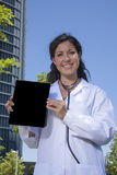 Doctor female showing screen Royalty Free Stock Photo