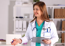Doctor with File folders, standing on  shelves in the background Stock Image