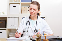 Doctor with files in her office Royalty Free Stock Image