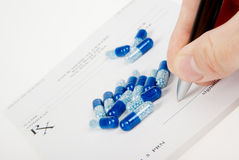 Doctor filling in empty medical prescription Royalty Free Stock Image