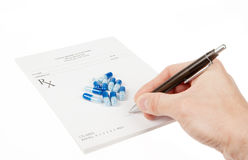 Doctor filling in empty medical prescription Stock Photo