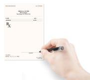 Doctor filling in empty medical prescription Stock Photos