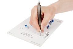 Doctor filling in empty medical prescription Stock Image