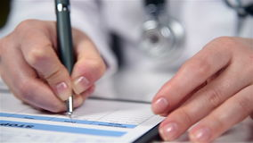 Doctor Filling Medical History stock footage