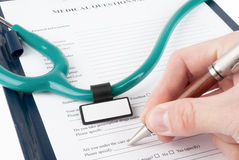 Doctor filling in medical questionnaire document Stock Images