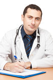 Doctor filling out medical document Royalty Free Stock Photo