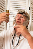 Doctor filling syringe Stock Photo