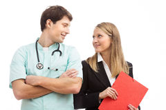 Doctor and finance specialist in hospital royalty free stock image