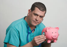 Doctor financial concept Stock Photos