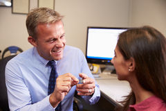 Doctor Fitting Female Patient With Hearing Aid Royalty Free Stock Photo