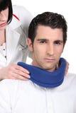 Doctor fitting a neckbrace Royalty Free Stock Photography