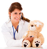 Doctor fixing a sick teddy bear Stock Photography