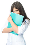 Doctor with a folder. Beautiful shy doctor with a green folder and a stethoscope against white background Stock Image