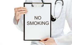 Doctor forbidding smoking stock photos