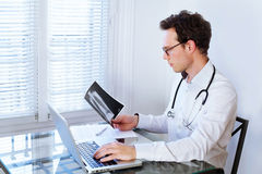 Doctor in front of computer stock image