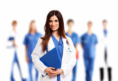 Doctor in front of her medical team Stock Image