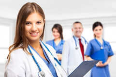 Doctor in front of her team Stock Photo