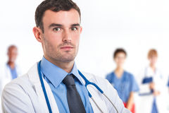 Doctor in front of his medical team Stock Photography