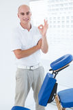Doctor in front of medical chair Royalty Free Stock Photo
