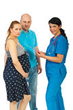 Doctor and future parents discussion Stock Image